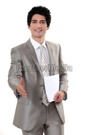 a businessman about to shake hands