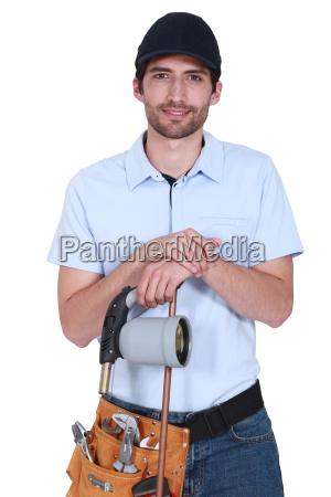 handsome plumber wearing cap