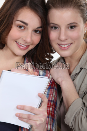 two female friends with notepad