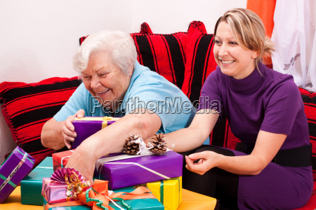 senior and young woman get gifts