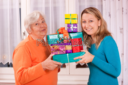 old and young woman keep many