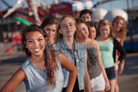 happy girl with jealous friends