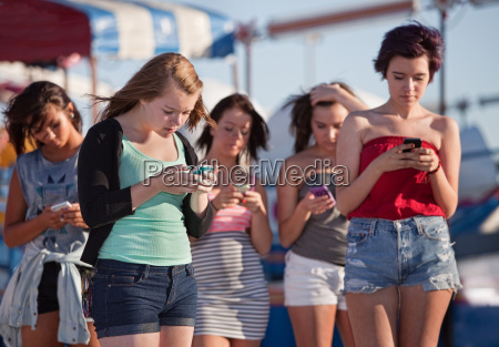 young ladies using their phones