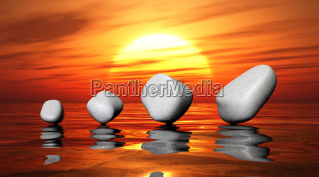 white stones on sunset water