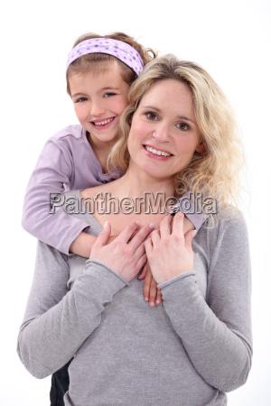daughter hugging her mom