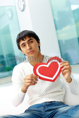 man with paper heart