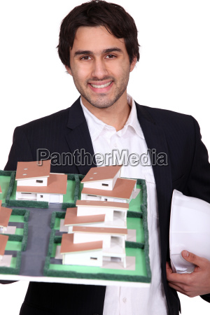 young architect holding a model of