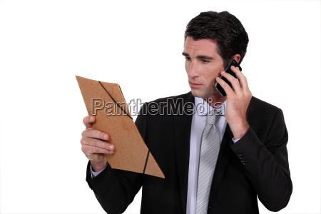concerned businessman talking on the phone
