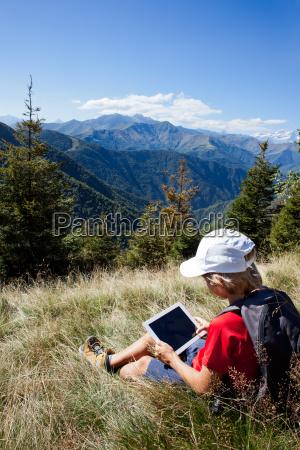 boy sitting in a mountain meadow
