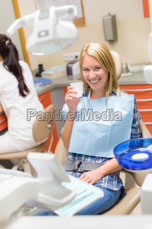 smiling patient sit dental chair modern