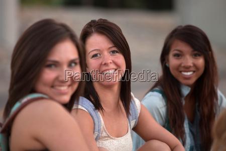 three pretty teen students