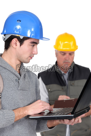 young craftsman working on his laptop