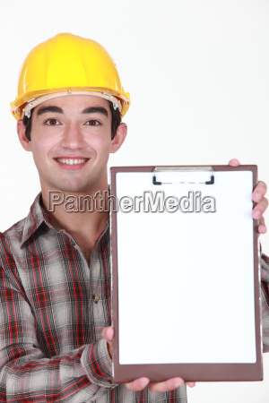 young construction worker holding up a