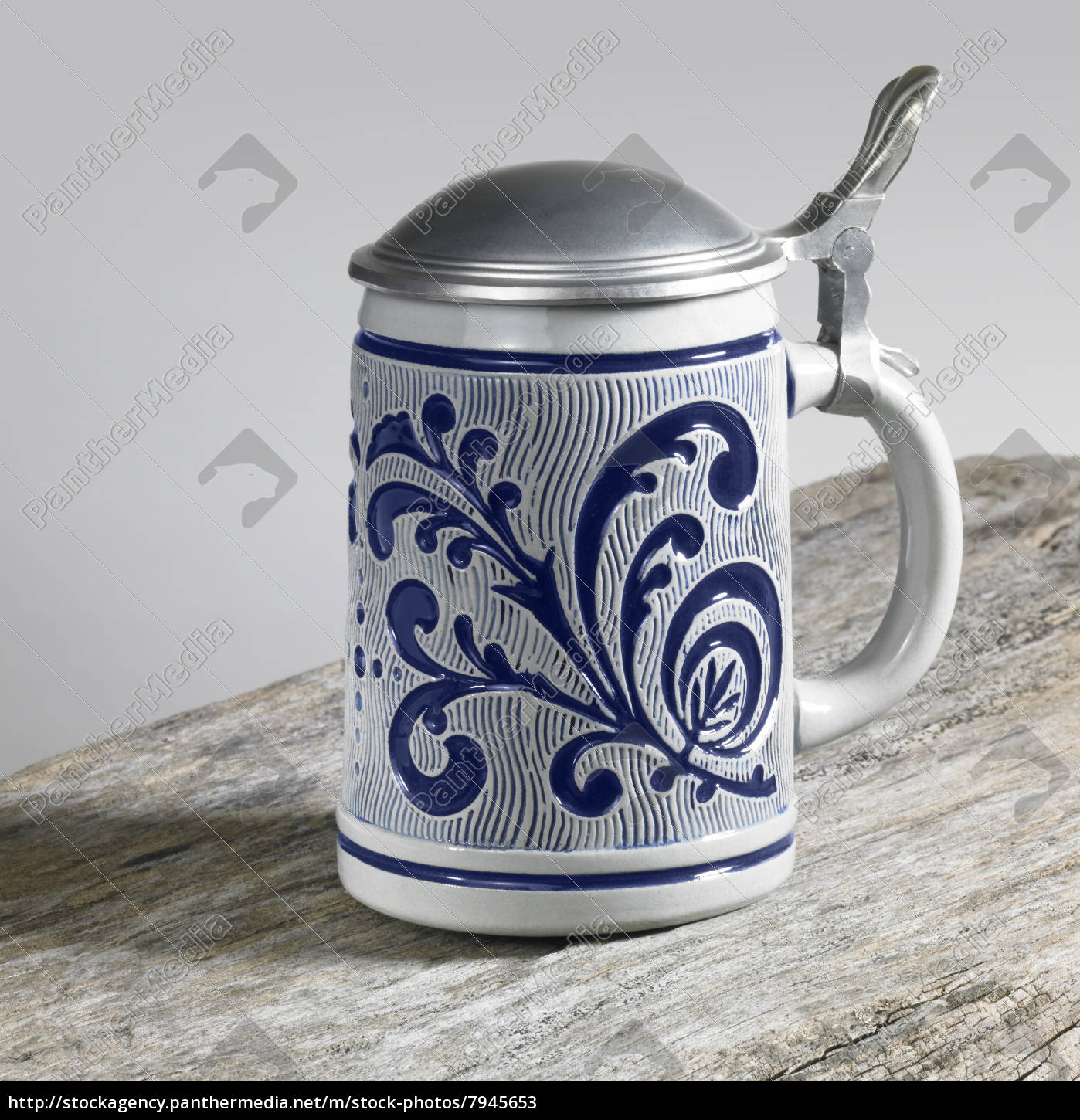 blue, decorated, stein, on, wooden, surface - 7945653