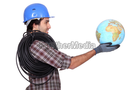 electrician holding a globe