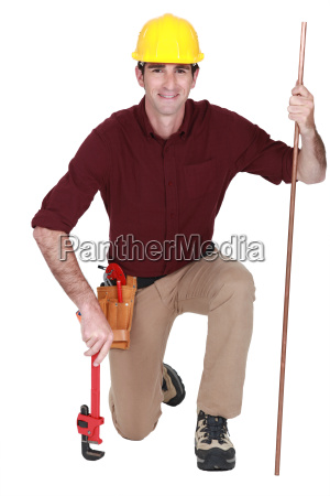 portrait of handsome plumber with adjustable