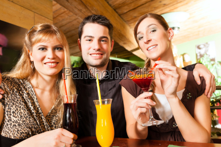 young people drinking cocktails in a