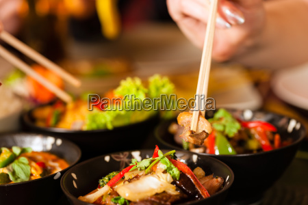 young people eat in a thai