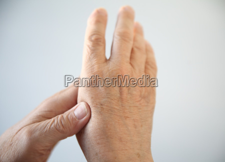 man with aching hand
