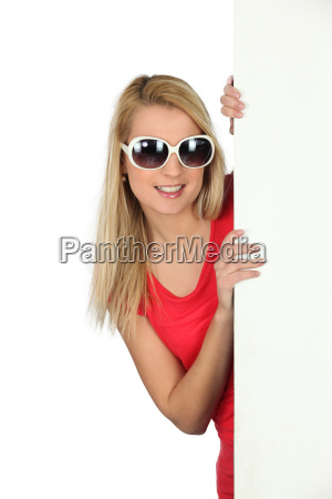 woman in sunglasses with a blank