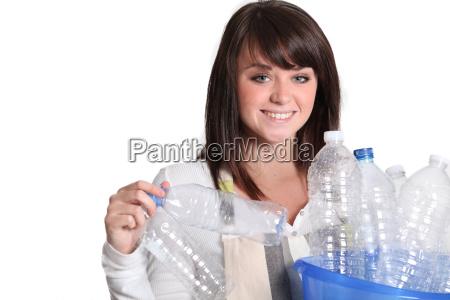 woman gathering plastic bottles