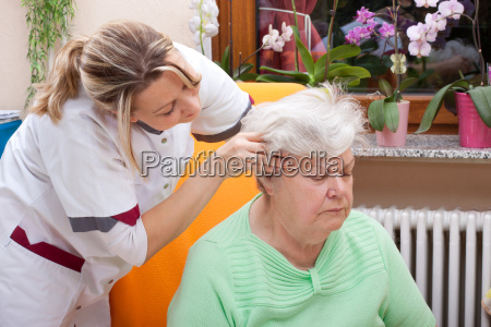 carer massaging the head of a