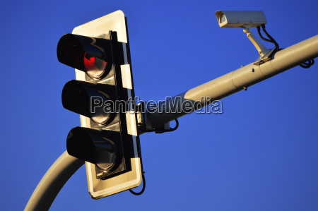 traffic lights over a blue sky
