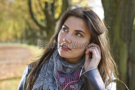 woman in part with earphones