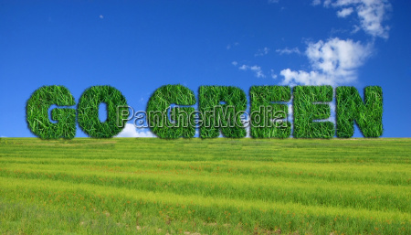 go green sign over fresh grass