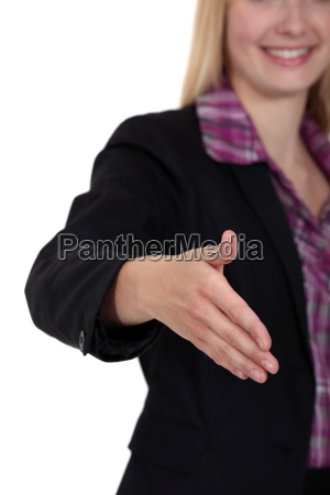 woman holding her hand out for