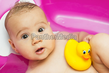 cute baby playing with duck toy