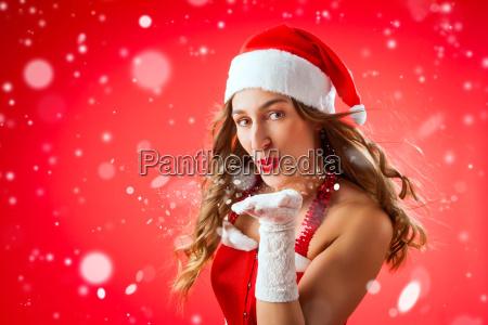 christmas woman at christmas blows snow