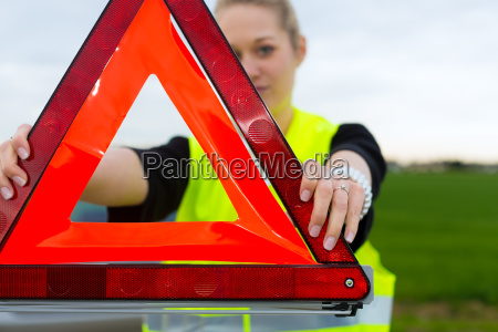 young woman with warning triangle on