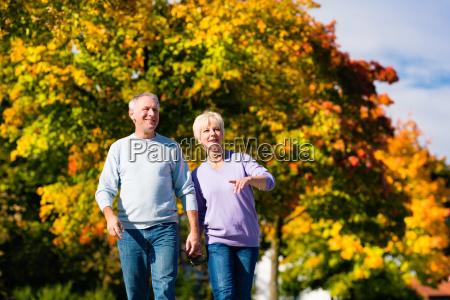 seniors in autumn on walk in