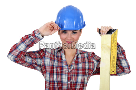 female apprentice looking pleased with ruler