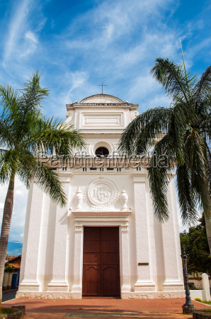 white church with palm trees
