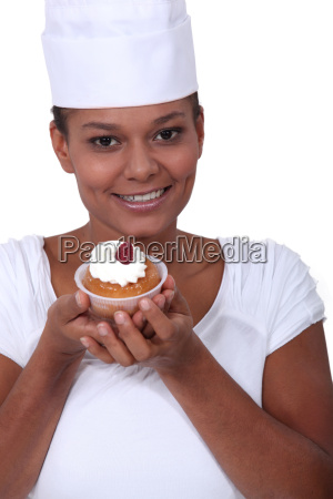 chef showing off a cupcake