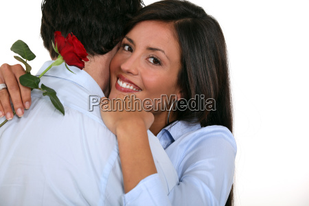 couple with rose in hand