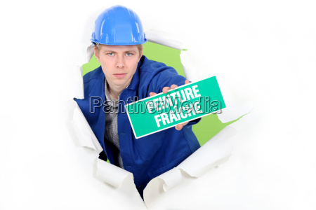 tradesman holding a wet paint sign
