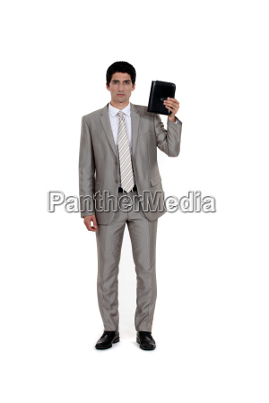 businessman with diary isolated on white