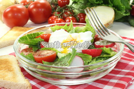 salad with poached egg onions and