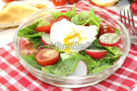 salad with poached egg tomatoes and