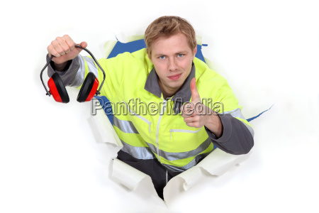 worker giving the thumbs up to