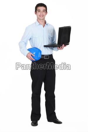 young businessman holding a helmet and