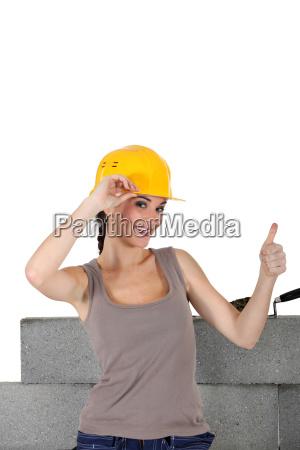 female stonemason giving the thumbs up