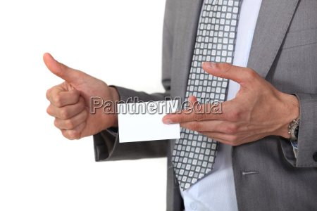 man displaying business card