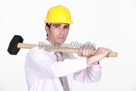 an architect with sledgehammer