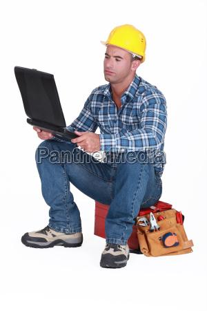 tradesman checking his emails