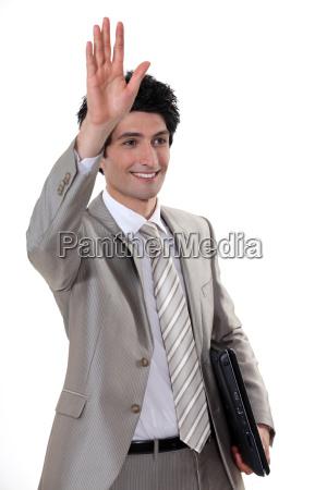 a businessman waving to someone