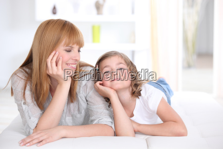 mother and daughter laying down at